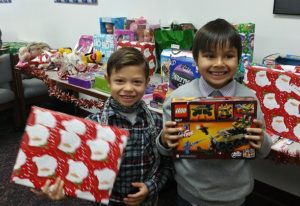 Two boys get gifts at Friends Outside's Christmas party!